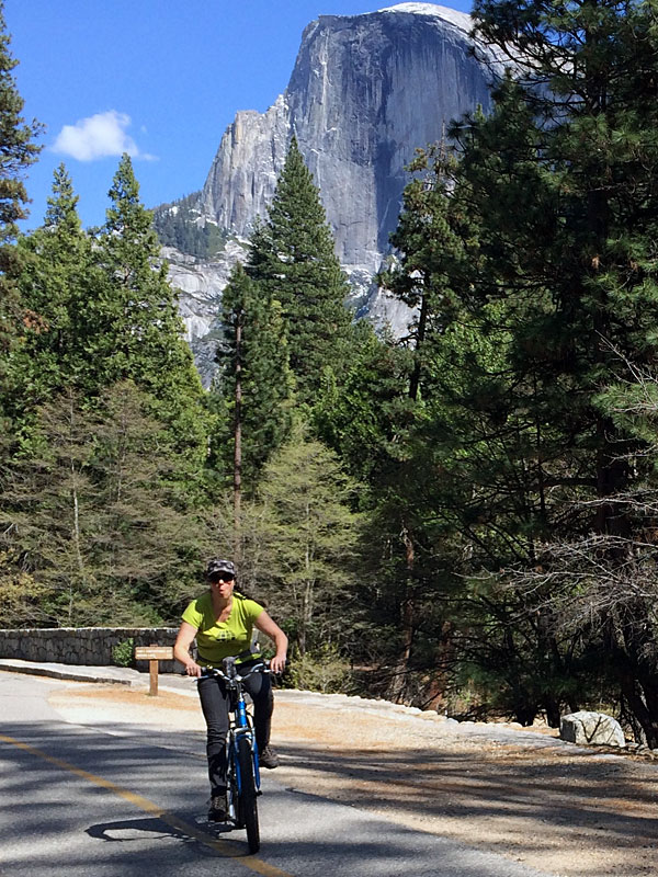 Kim goofs around while biking below Half Dome