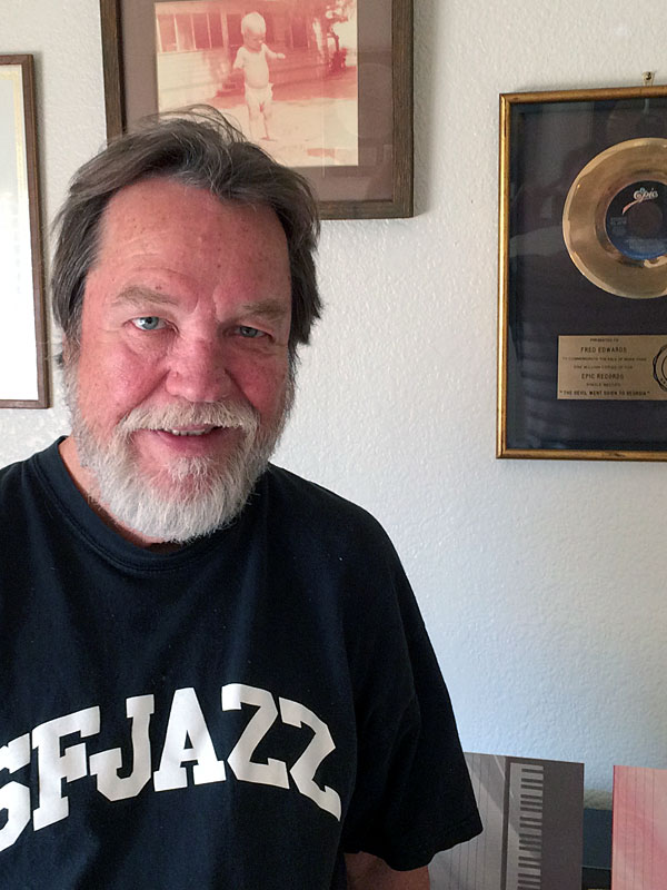 Uncle Freddie shows off his gold record for The Devil Went Down to Georgia