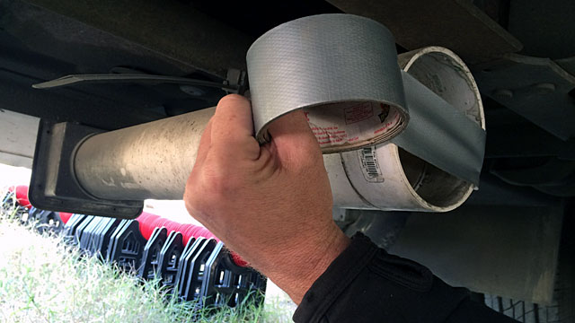 Patching the sewer pipe storage tube with duct tape.