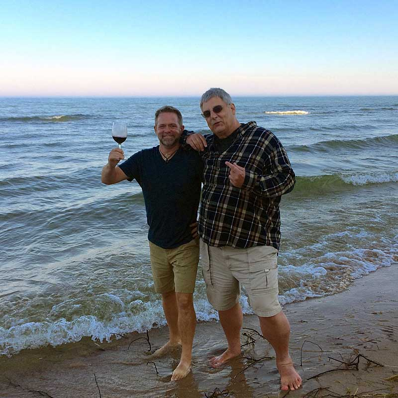 J.D. and Jim, walking the beach...